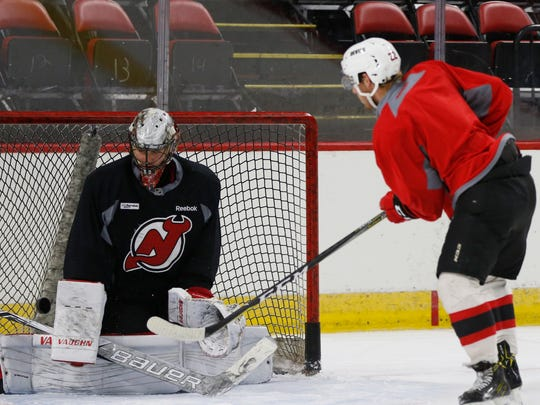 Binghamton Devils goalie, Mackenzie Blackwood stops a shot from forward Brandon Gignac during Tuesday's practice at Maines Arena on October 3, 2017.