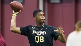 Jameis Winston warms up during Florida State football pro day in Tallahassee, Fla., Tuesday, March 31, 2015.