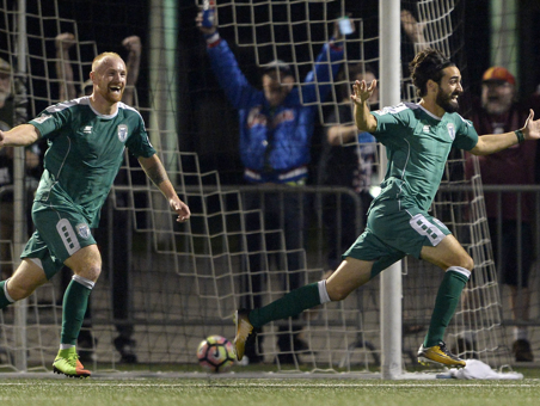 Rhinos forward Jochen Graf, left, runs to catch up with Stefan DeFregger to celebrate DeFregger's game-winning goal in overtime in a USL playoff match in the 2017 season. Graf led the team in scoring and wanted to stay in Rochester, but with the club's decision to go dark for 2018 he can't play pro soccer here.