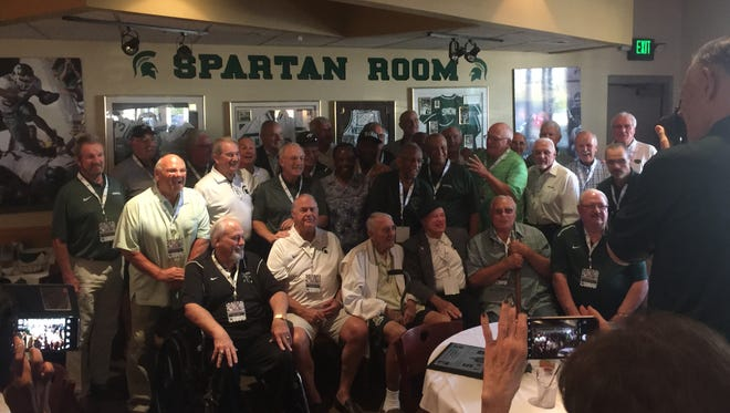 Players from both the Michigan State and Notre Dame 1966 teams that played to a 10-10 tie pose for pictures Saturday, Sept. 23, 2017 in East Lansing.