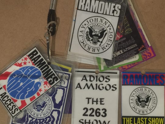 A stack of laminated backstage passes from Ramones