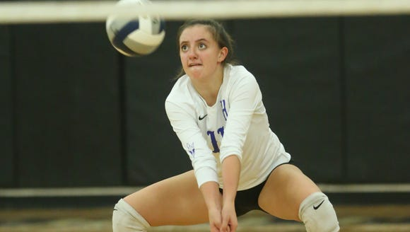 Haldane's Olivia Monteleone (11) digs a serve during