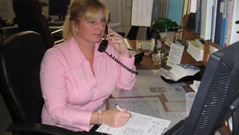 Cheryl Parker answers a call for CONTACT of Ocean and Monmouth Counties.