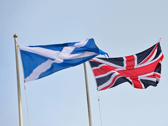 The Union Flag and Saltire, the national flag of Scotland, are flown above above Horseguards in London on Sept. 17.