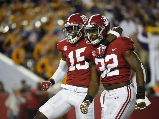 Nov 4, 2017; Tuscaloosa, AL, USA; Alabama Crimson Tide linebacker Rashaan Evans (32) and defensive back Ronnie Harrison (15) react after a play against the LSU Tigers during the first quarter at Bryant-Denny Stadium.