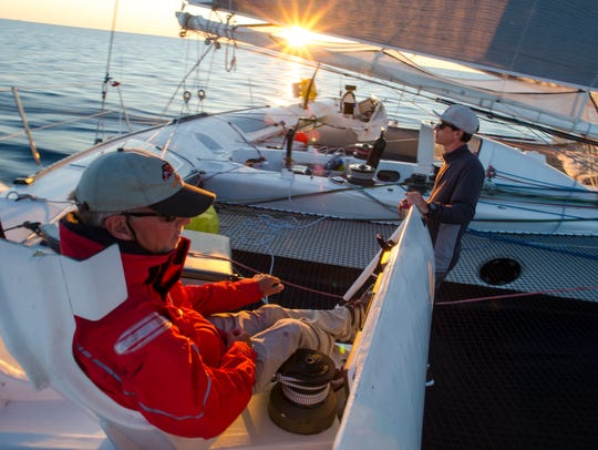 Arete skipper Rick Warner chats with crew member Matthew