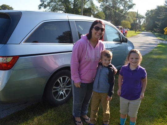 Sarah Boatman picks up her children Jaxson and Brooklyn after Croghan Elementary School was closed for a bomb threat.