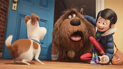 "In this image released by Universal Pictures, from left, characters Max, voiced by Louis C.K., Duke, voiced by Eric Stonestreet, and Katie, voiced by Ellie Kemper, appear in a scene from, ""The Secret Lives of Pets."""