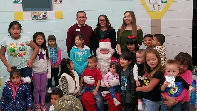 Pictured are children of Jardin de Los Ninos, Santa and staff attendants from Bank of the West. From left Branch Manager Osvaldo Luna, Rachel O'Hara and Najellie Garibay the rest of the staff not in the photo  are Layla Albo, Kelsey Fissel, Liz Torres, Estevan Ortiz and Michael Zamora.