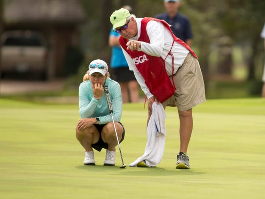 Naples' Mary Jane Hiestand listens to her caddie -- her husband Jeff -- as she prepares to putt on the sixth green during the final round at the 2017 U.S. Women's Mid-Amateur at Champions Golf Club in Houston, Texas on Thursday.. Darren Carroll/USGA