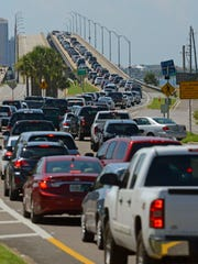 Drivers wait in line to get over to Pensacola Beach