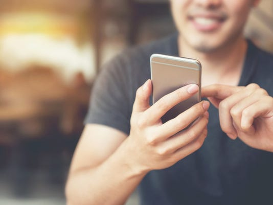 Happy man using smartphone and copy space