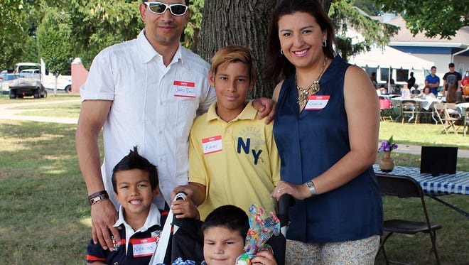 Joshua Rincon with his family at Matheny's annual picnic. Clockwise from left: brother Nicolas, father Jairo, brother Adrian and mother Grecia.