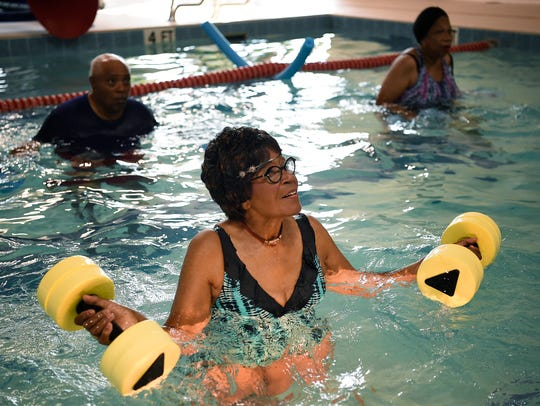 Sallie Lowe enjoys a water aerobics class at the Bordeaux