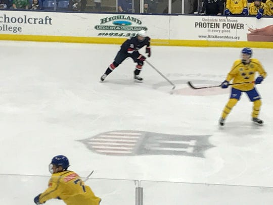 Players from the U.S. and Sweden Under-18 teams skate