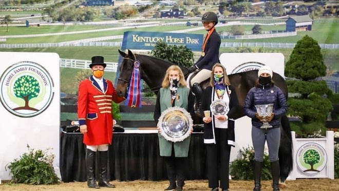 "Lincoln-Sudbury senior Carolyn Tinsley sits atop her sister's horse, Zonder Z Quattro, after she won the 3'3"" National Equitation Championship at the 2020 Hamel Foundation National Horse Show in Kentucky on Oct. 25."