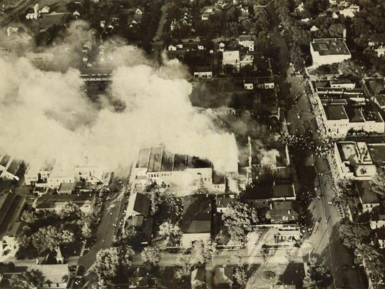 Smoke billows over Spencer during the June 1931 fire that started in the fireworks supplies at Bjornstad Drug Store.