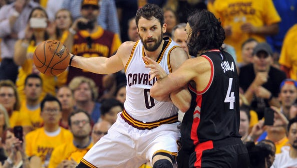 Cleveland Cavaliers forward Kevin Love (0) drives on
