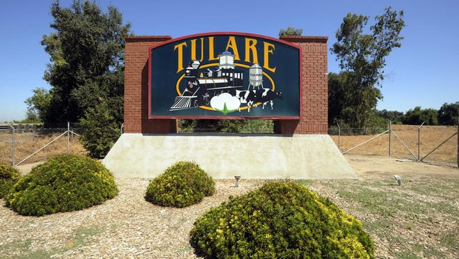 Photo for Circ. rack card- Tulare sign appears just south of town on east side of Highway 99, just south of Avenue 200. Photo taken on 8/2/10 in Tulare. Photo by Steve R. Fujimoto 0802_Tul_Sign_4650 Camera data: 8/2/10 at 11:22:09 AM, ISO 200, 1/250 @ f/11, WB=CLOUDY, 17mm, , FINE, frame 4650.