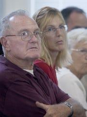 Andrew L. Sperr, left, father of slain state Trooper