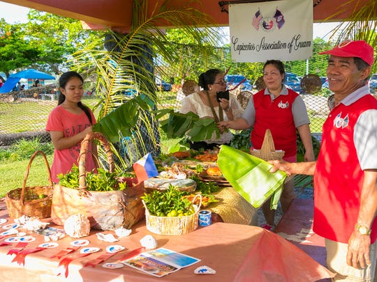 Members of Capizenos Association of Guam offer food during the Pista Sa Nayon Philippine Independence/Father's Day Celebration held at Ypao Beach on June 21.