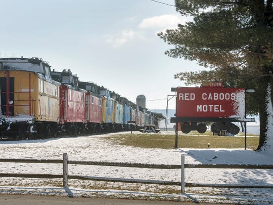 A line of cabooses, each one an individual suite of rooms with a full bathroom wait for guests at The Red Caboose Motel and Restaurant in Ronks.