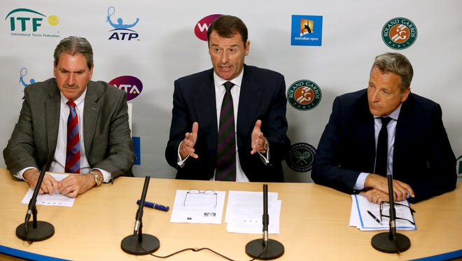 Wimbledon Chairman Philip Brook,  center,  speaks, along with ATP Executive Chairman and President Chris Kermode, right, and International Tennis Federation President David Haggerty, left, during a press conference at the Australian Open tennis championships Wednesday in Melbourne. Responding to reports that possible evidence of match fixing was not properly investigated, tennis' governing bodies are setting up an independent review of the sport's anti-corruption group.