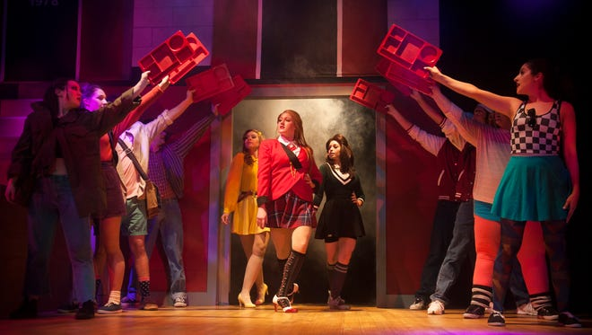 Cast members of 'Heathers The Musical' are (center, from left)  Jordan O'Brien of Atco who portrays Heather McNamara; Jessica Huch of West Creek, who portrays Heather Chandler, and Justina Ercole of New York City, who portrays Heather Duke. They perform a dress rehearsal at the Eagle Theatre in Hammonton.