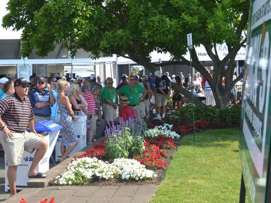 Gallery gathers around the first tee at En-Joie Golf
