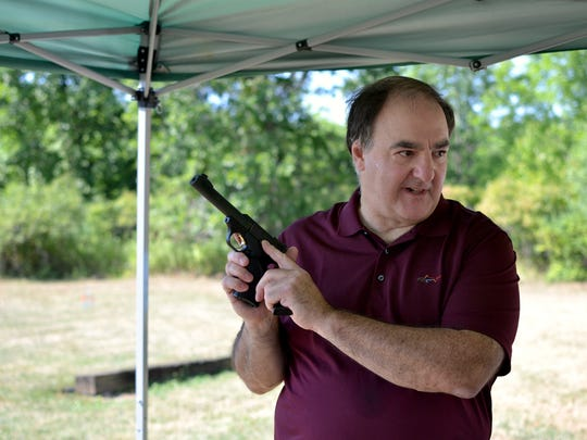 Jim Kinsman, an NRA-certified instructor, acted as the director of Saturday's Women on Target program at the Victor Rod & Gun Club.