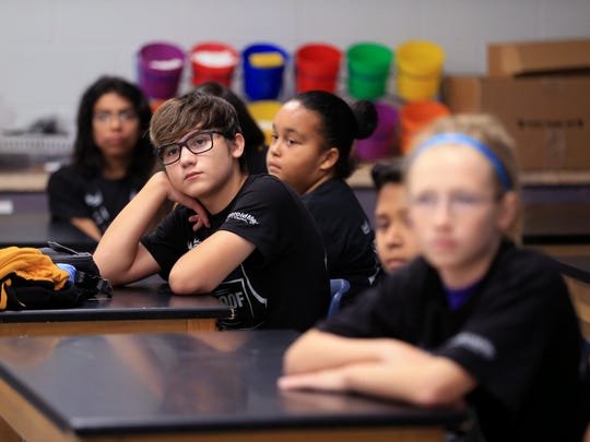 Metro Elementary School of Design student Jacob Zirbes (center), 12, listens as Corpus Christi Independent School District Police Sgt. Janelle Cantu thanks students in the BullyProof program for investing their time at the program graduation on May 26, 2017. Students spent weeks together learning how to make good choices and how to deal with situations that might come up in their every day life.