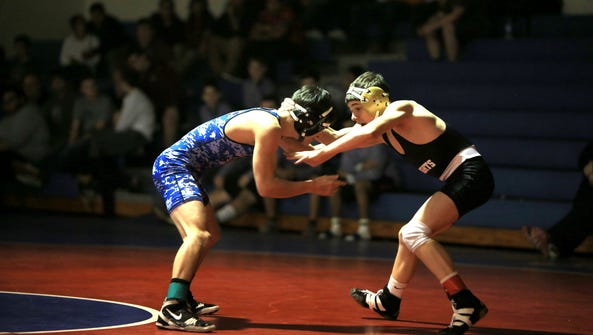 Josh Blatt, right, wrestles at 106 pounds for North