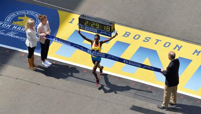 Atsede Baysa of Ethiopia crosses the finish line of the 2016 Boston Marathon to win the women's title.