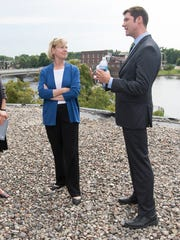 Sen. Tammy Baldwin meets with, from left, Incourage Community Foundation's chair Kristopher Gasch and Tribune building project manager Chelsey Mazurek and Mayor Zach Vruwink to discuss the plans for the Tribune building in Wisconsin Rapids, Wednesday, July 20, 2016.