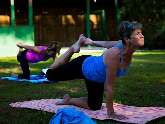 Julie Hammond focuses on her pose during flamingo yoga