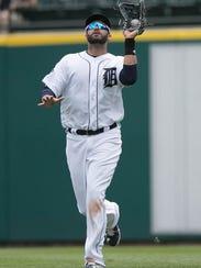 Tigers rightfielder J.D. Martinez catches a fly ball