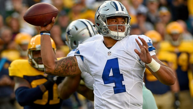 Dallas Cowboys quarterback Dak Prescott (4) throws the ball in the second quarter during the game against the Green Bay Packers at Lambeau Field.