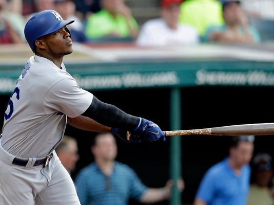 Los Angeles Dodgers' Yasiel Puig watches his two-run home run off Cleveland Indians starting pitcher Trevor Bauer during the second inning of a baseball game, Tuesday, June 13, 2017, in Cleveland. (AP Photo/Tony Dejak)