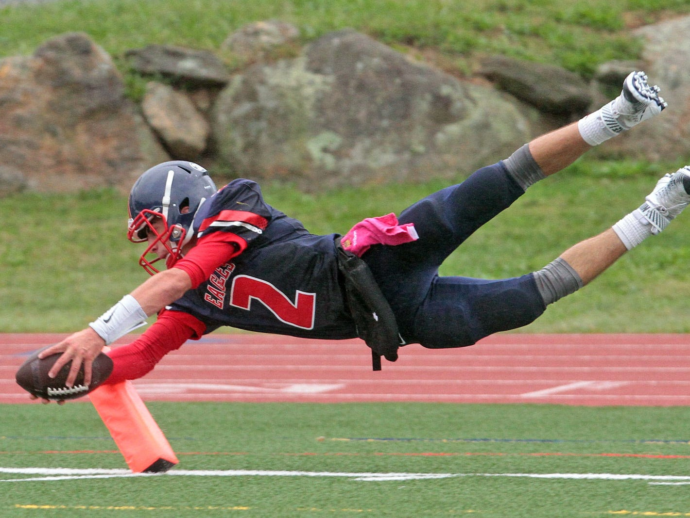 Eastchester quarterback John Arcidiacono capped a 67-yard touchdown run with a dive into the end zone during a varsity football game against Pearl River at Eastchester High School Oct. 3, 2015. Eastchester cruised to a 31-7 victory over Pearl River.