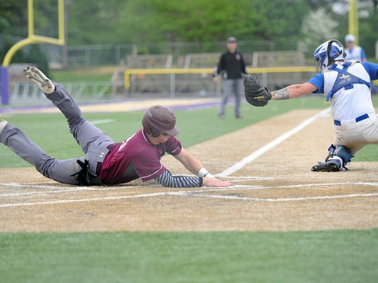 Manheim Central's Dan Wiederrecht scores ahead of the tag on a sacrifice fly ball from Blake Reiff. The Barons advanced with a 10-2 victory over the Pioneers at Ephrata War Memorial Field on Saturday, May 9, 2015. Patrick Blain for GameTimePA.com