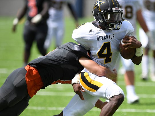 Autauga Academy's Kendrick Rogers (4) runs against
