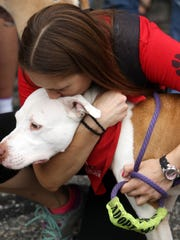 Nicole Filicetti of Danville, a volunteer at 11th Hour Rescue gives a kiss to Oliver during Morris County Park Police and the Morris County Park Commission sponsored 'National Night Out,' an evening of awareness and fun with free food, free entertainment, free skating, giveaways and free attractions. August 2, 2016, Morris Twp, NJ