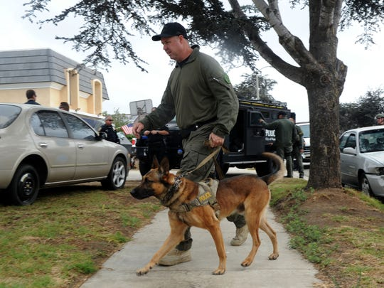 JUAN CARLO/THE STARDaniel Casson, Oxnard senior officer along with his dog Jax start searching for narcotics outside and inside a house in the Marina West Neighborhood in Oxnard. Oxnard police along with the SWAT Team did a drug bust on Friday morning. They received a lot of complaints about this house from the neighborhood. Police said it brings a lot of shady people around. 08/26/16 Oxnard, Ca