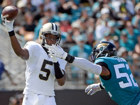 New Orleans Saints quarterback Teddy Bridgewater (5) releases a pass just before he is hit by Jacksonville Jaguars linebacker Najee Goode (52) during the first half of an NFL football game, Sunday, Oct. 13, 2019, in Jacksonville, Fla. (AP Photo/Phelan M. Ebenhack)
