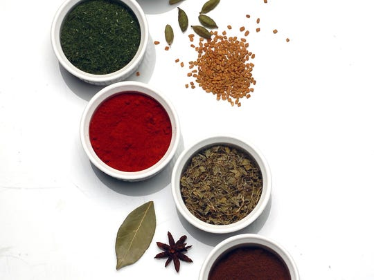 Since so many people make getting organized their New Year's resolution, your spice cabinet is a good place to start. Pictured from top, cinnamon, tandoori blend, dill, sweet Spanish paprika, fenugreek, cloves and curry, along with cardamom pods, fenugreek seeds, bay leaf and star anise.