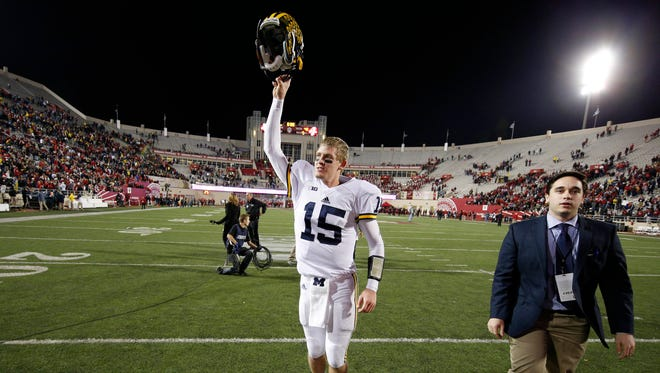 Michigan quarterback Jake Rudock reacts to a victory over the Indiana Hoosiers at Memorial Stadium. Michigan won, 48-41, in double overtime.