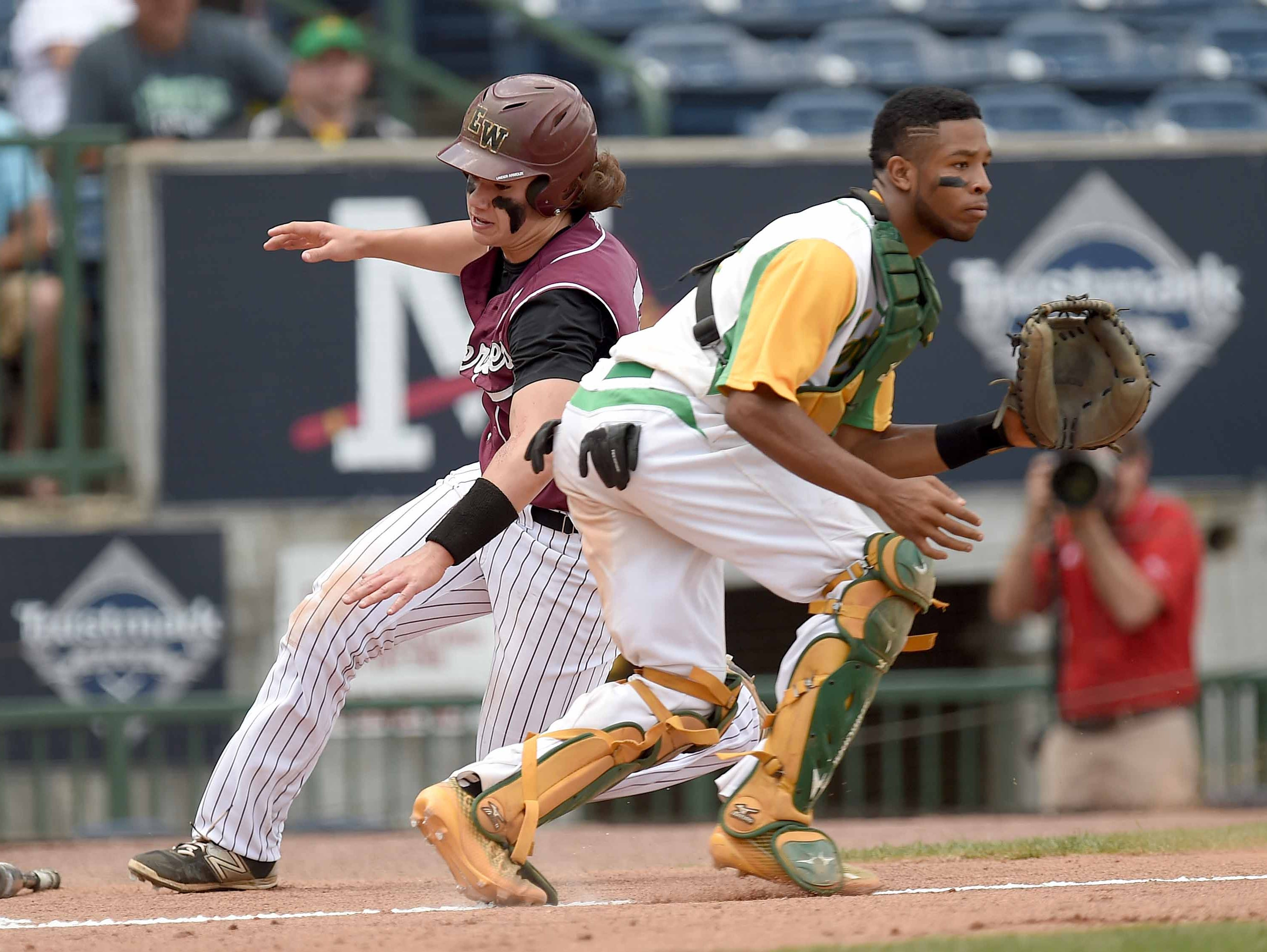 East Webster's Luke Wilson dashes home behind Taylorsville catcher Austin Moffett Saturday in game three of the Class 2A State Championship series at Trustmark Park in Pearl.