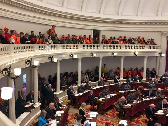 Gun-rights activists, dressed in orange, fill the gallery of the House of Representatives during a debate on gun restrictions at the Statehouse in Montpelier on March 27, 2018.