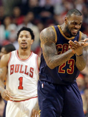 Will LeBron James, left, and the Cavaliers win the Eastern Conference or can Derrick Rose, left, and the Bulls make a push?