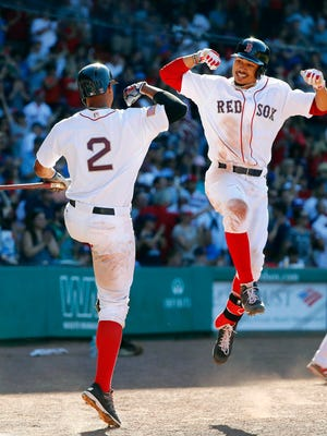 Oufielder Mookie Betts, right, and shortstop Xander Bogaerts weren't always able to celebrate the Boston Red Sox's  success in 2017.